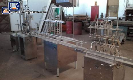 Linear filling machine with 4 stainless steel spouts
